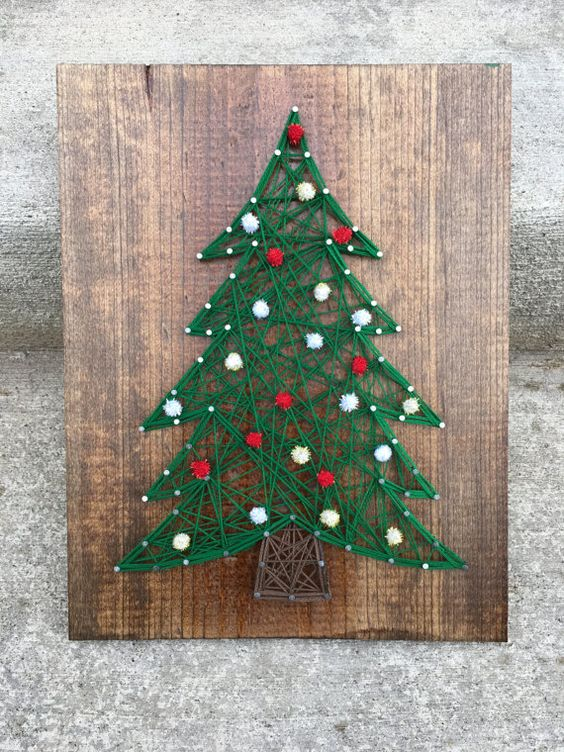 a Christmas tree string art decorated with red and white pompoms is great for winter