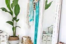 10 a boho beach bedroom with a mirror in a white shabby chic frame