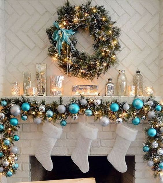 a garland with silver, striped and turquoise ornaments for decorating a mantel