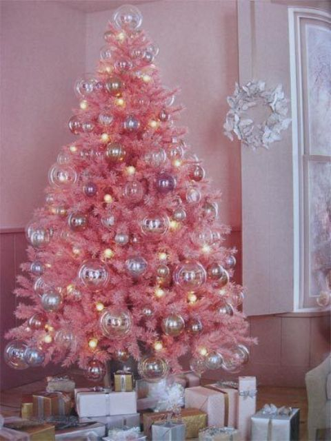 a pink Christmas tree with pastel ornaments and lights