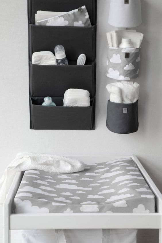 attach some fabric holders for diapers and other stuff over the changing table
