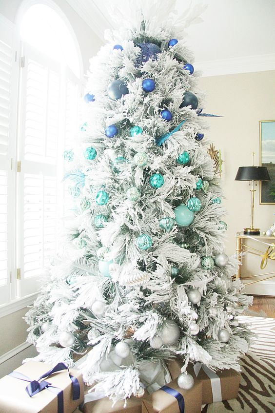 a flocked tree with ombre styling from electric blue to silver grey