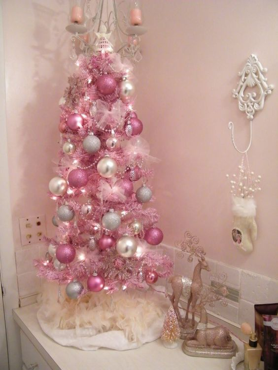 a bold pink Christmas tree with pearly, silver and pink ornaments