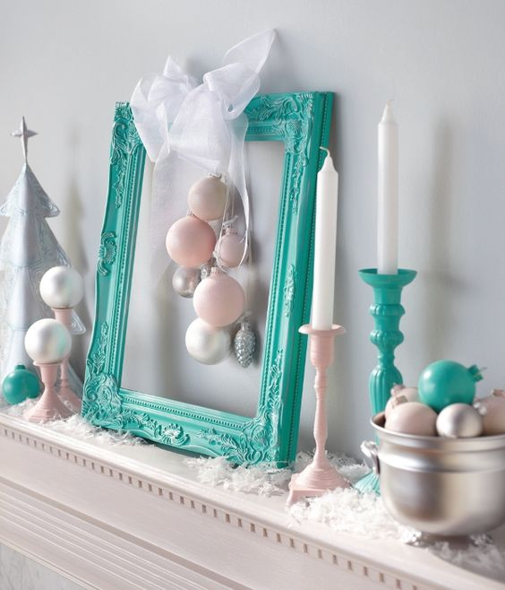 a turquoise frame with ornaments and some candle holders for modern decor