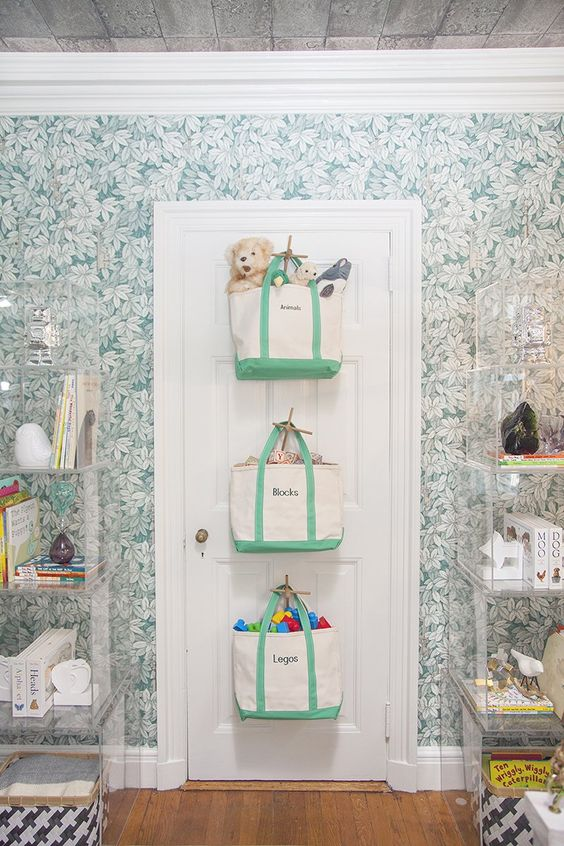 fabric bags attached to the door for storing everything your kid needs