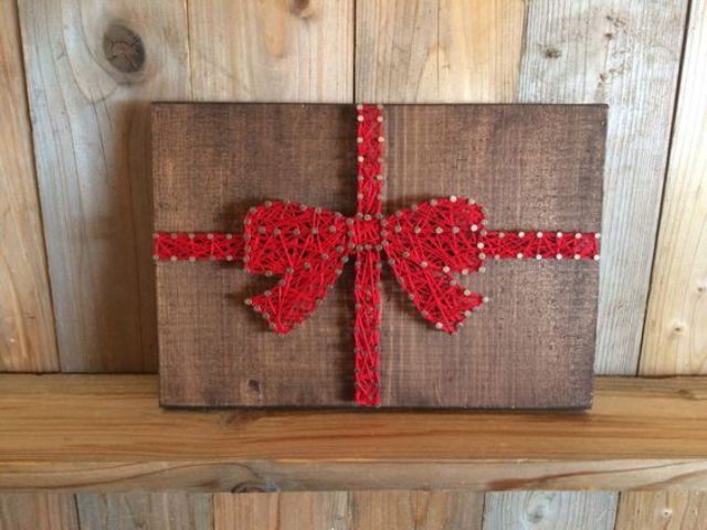 a gift with a red ribbon bow string art will add a whimsy touch