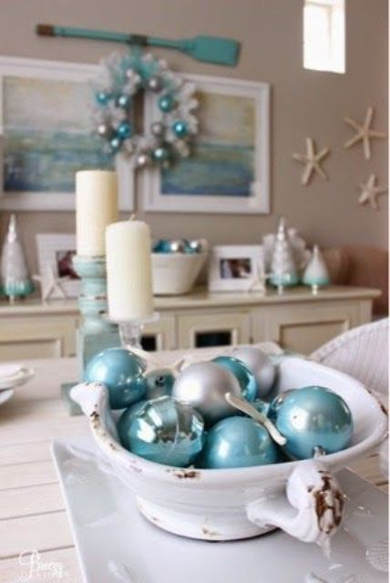 a vintage bowl with pearly and turquoise ornaments as a Christmas coastal display