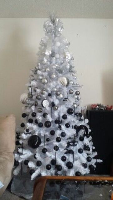 a white christmas tree with styling from silver to black - Black And Silver Christmas Tree