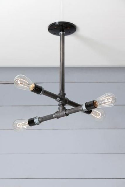 an industrial black pipe chandelier with four bulbs looks very laconic and clear