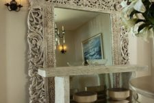 13 an oversized mirror in a fantastic carved wooden frame will catch anybody's eye