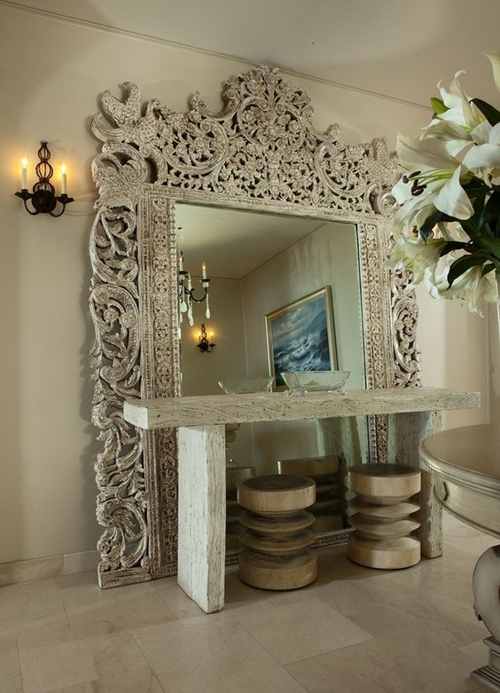 an oversized mirror in a fantastic carved wooden frame will catch anybody's eye