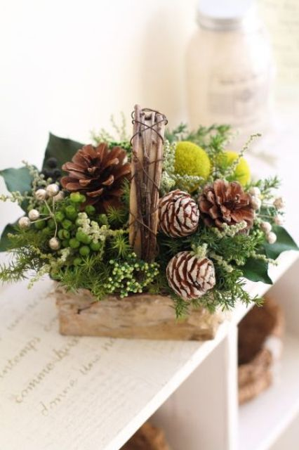 a basket with pinecones, billy balls, greenery and foliage for a strong festive spirit
