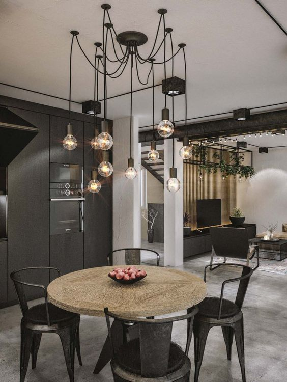 a black chandelier with bulbs and cords is ideal for an industrial dining space