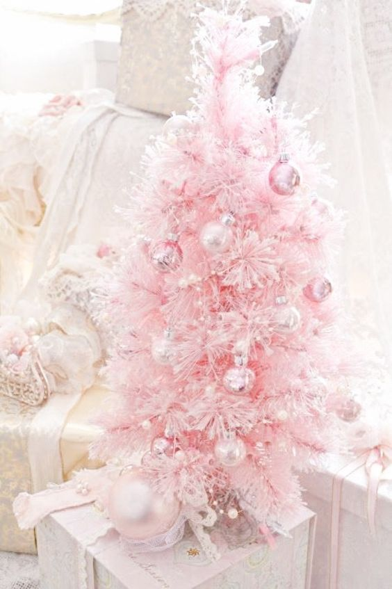 a pastel pink little tree with matching and silver ornaments for a sweet look