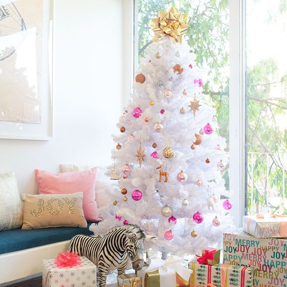 bold pink, gold, pearly and copper ornaments with a bold top bow are nice on a white tree