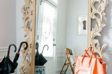 14 design a chic entryway with a mirror in a wood carved frame