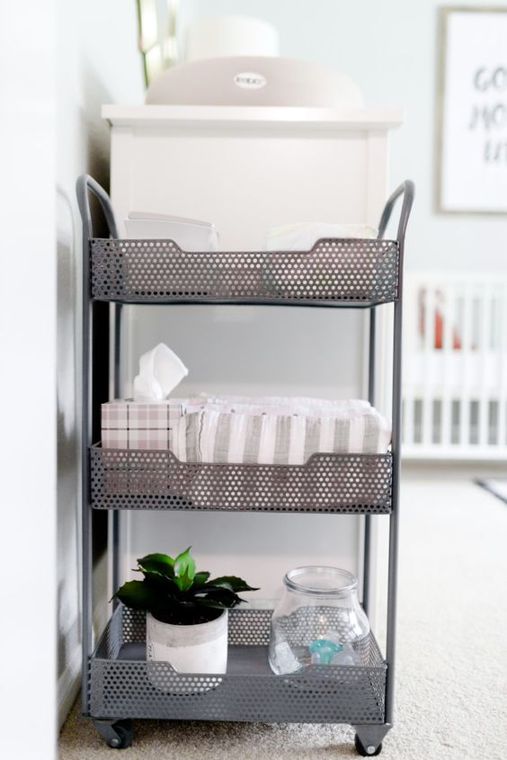 a metal cart for diaper supplies next to the changing table is always a smart idea