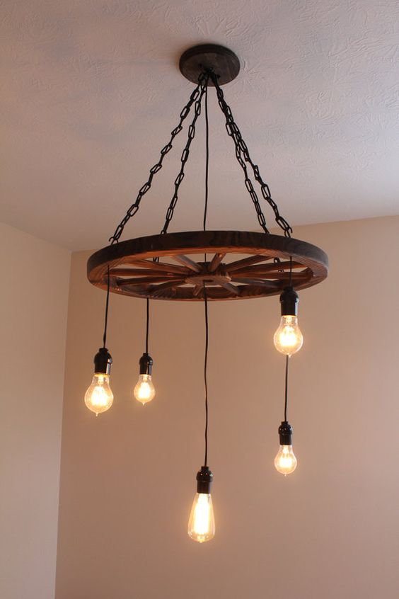 a vintage industrial chandelier of chain, a wheel and bulbs for a vintage space