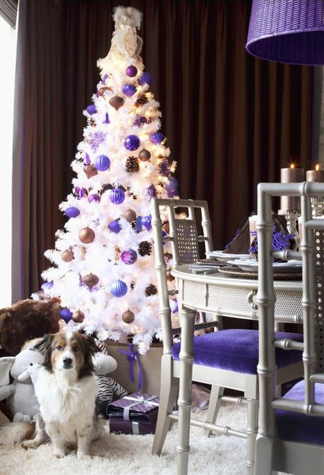 decorate the tree with bold purple, copper ornaments and pinecones for a unique look