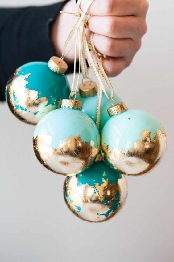 turquoise and mint Christmas ornaments with gold leaf look super cool