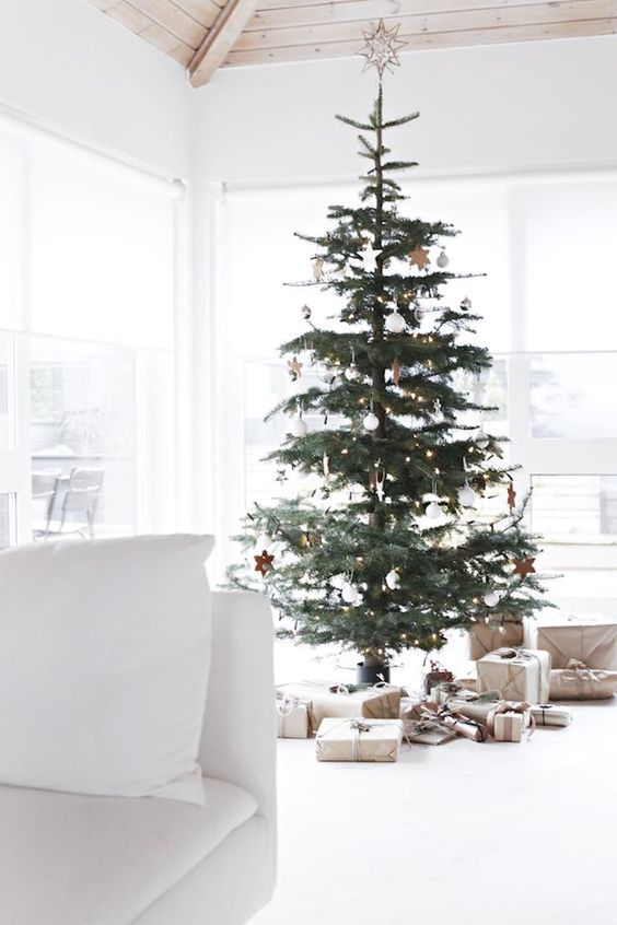 a tree decorated with white ornaments and stars for a Nordic feel
