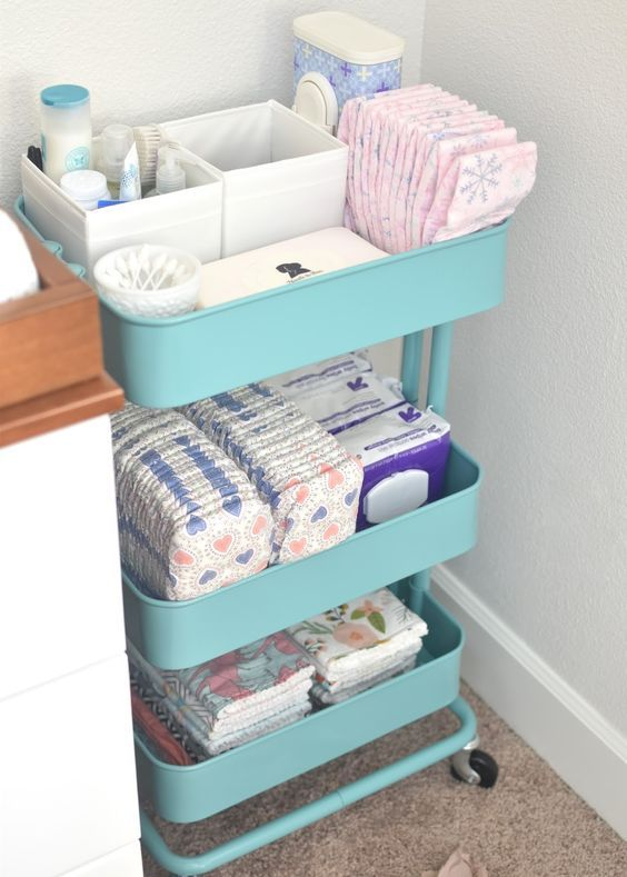 an IKEA cart can be turned into a diaper changing table with everything necessary
