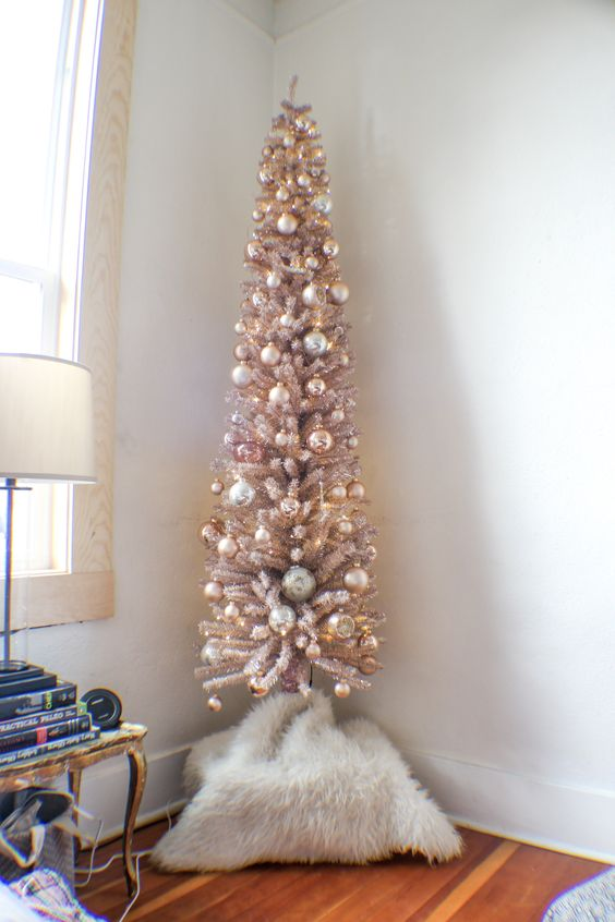 dusty pink sparkly Christmas tree with metallic ornaments looks shiny