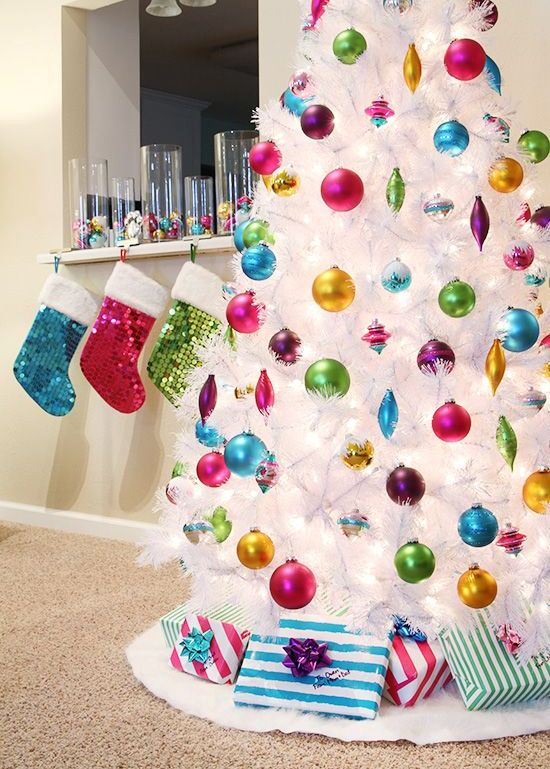 make your white tree stand out with super colorful ornaments of all possible shades