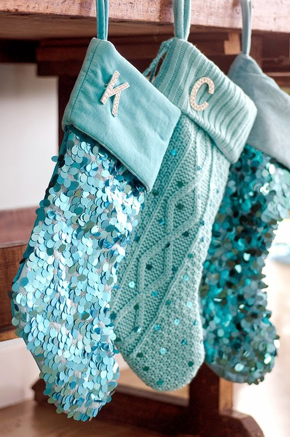 turquoise stockings with large sequins and monograms look awesome
