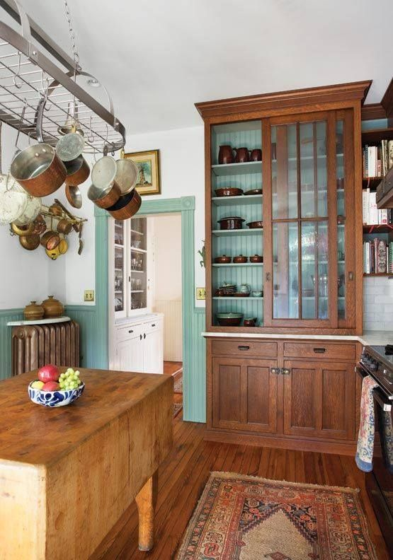 wooden cabinets with glass sliding doors are ideal for rustic vintage-inspired spaces