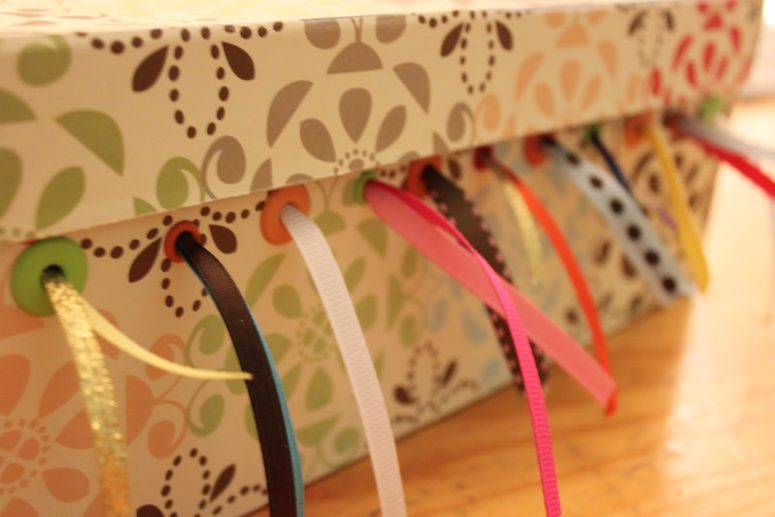 DIY shoebox ribbon storage (via delicateconstruction.com)