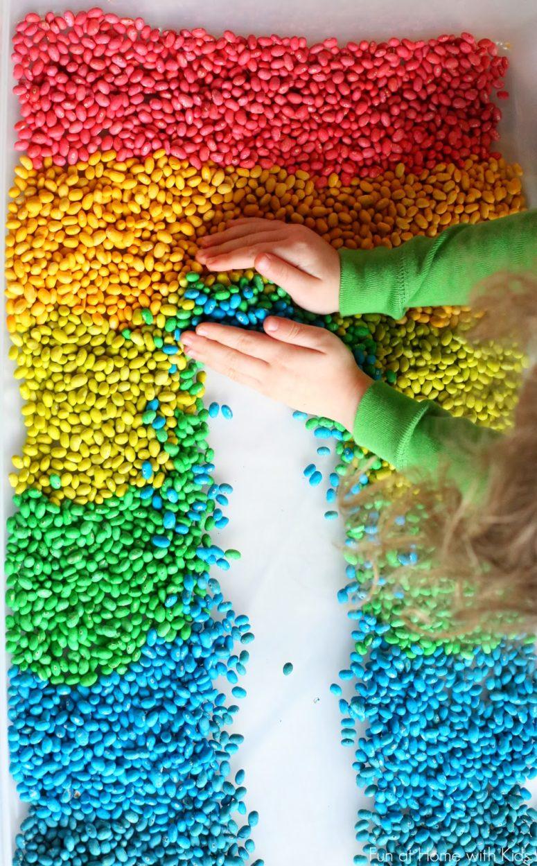 DIY sensory bin with colorful beans (via www.funathomewithkids.com)