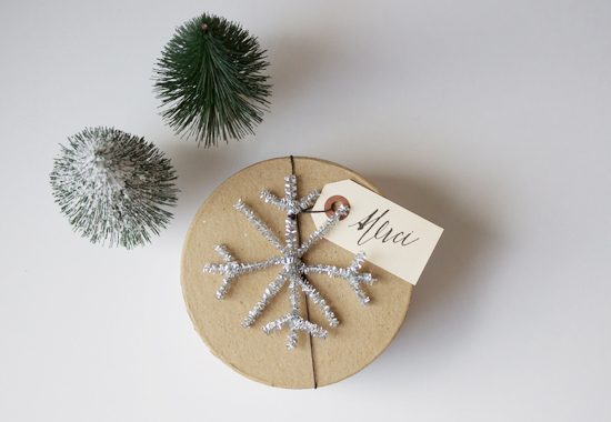 DIY tinsel snowflake gift toppers (via www.makeandtakes.com)