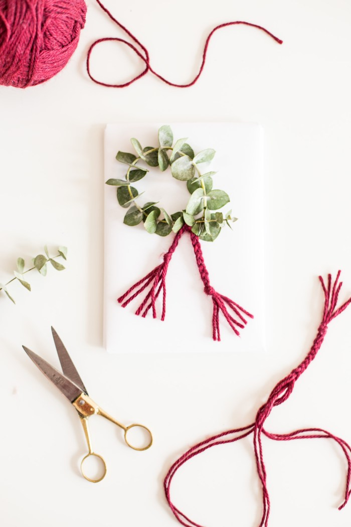DIY eucalyptus wreath with braids gift topper (via www.flaxandtwine.com)