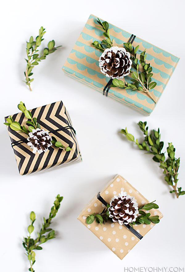 DIY box wood and snowy pinecone gift toppers (via www.homeyohmy.com)