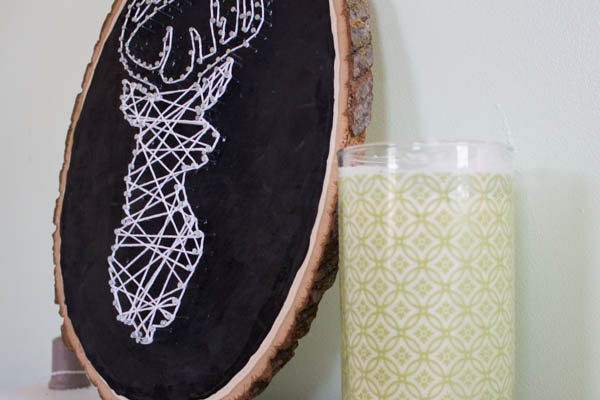 DIY deer string art in white on a chalkboard sign (via aweekfromthursday.com)