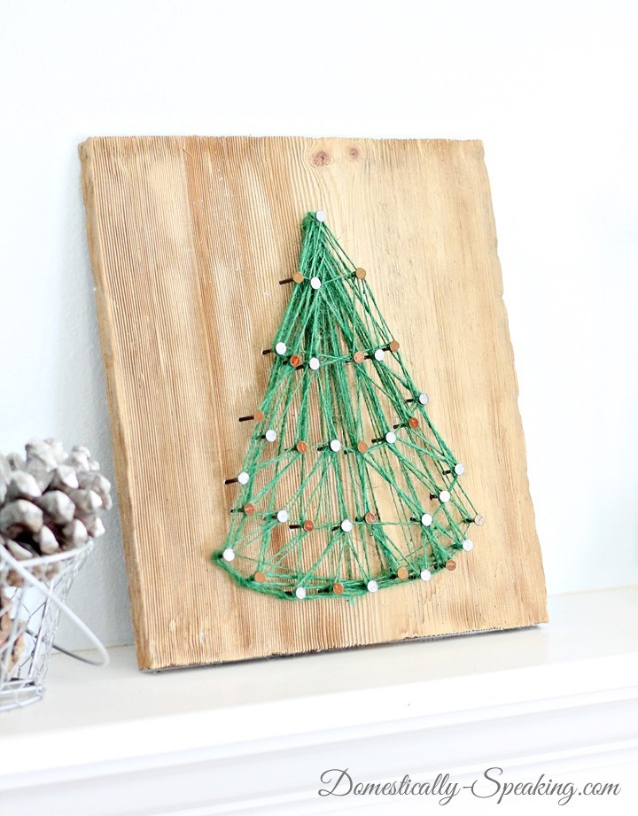 DIY string art Christmas tree in green (via www.domestically-speaking.com)