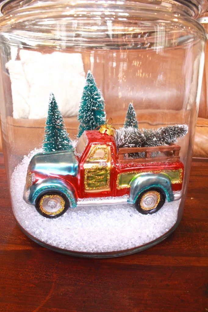 DIY Christmas terrarium with a truck and trees