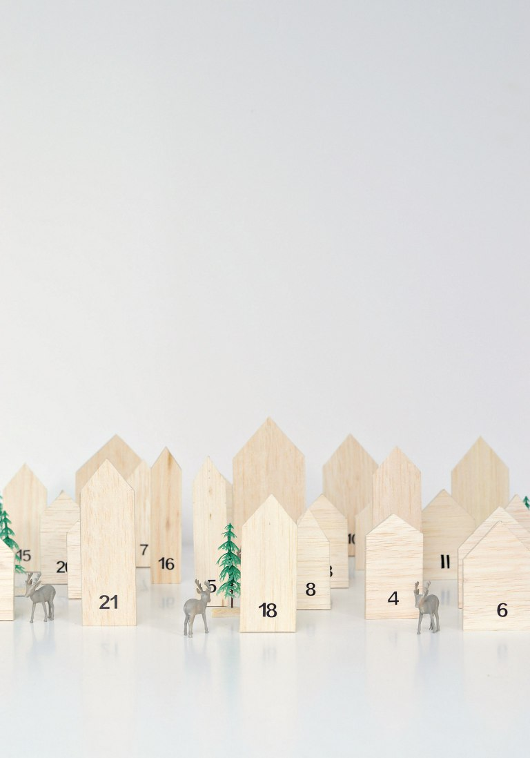 DIY wooden houses advent calendar (via yourdiyfamily.com)