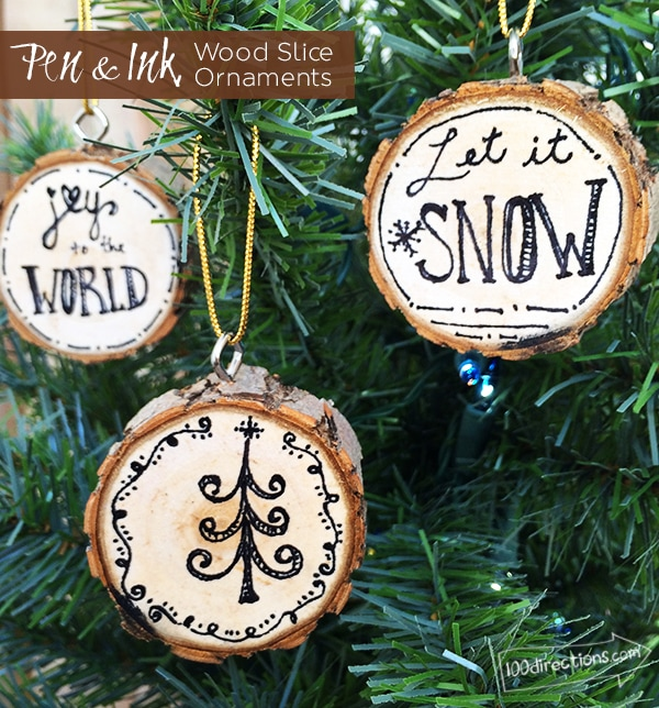 DIY pen and ink wood slice ornaments (via www.100directions.com)