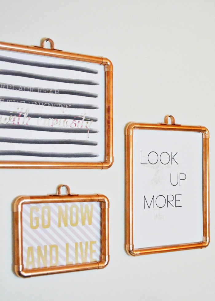 DIY copper pipe poster frames (via www.ajoyfulriot.com)