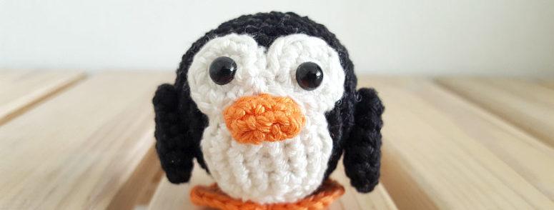 DIY crochet penguing with bead eyes (via www.sugaridoo.com)