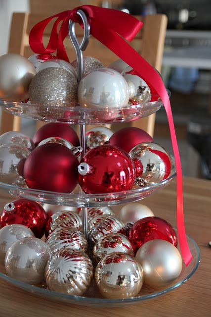 put silver, champagne and red ornaments on a glass stand for a cool look