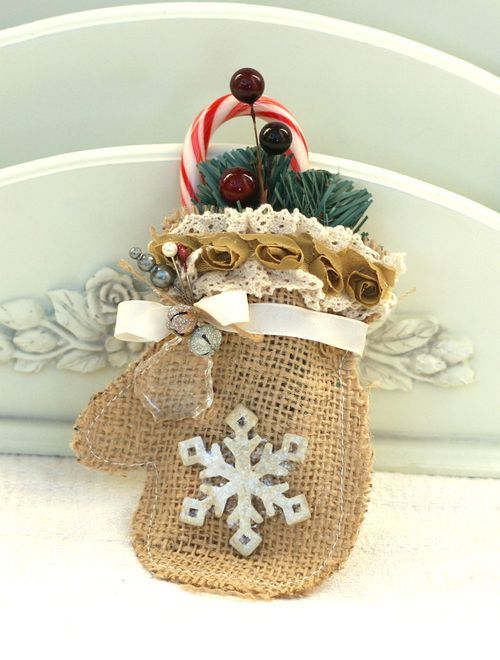 a burlap mitten ornament with beads, jingle bells and a silver snowflake