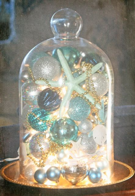 ornaments in the shades of blue, with strands of pearls and star fish for a beach Christmas