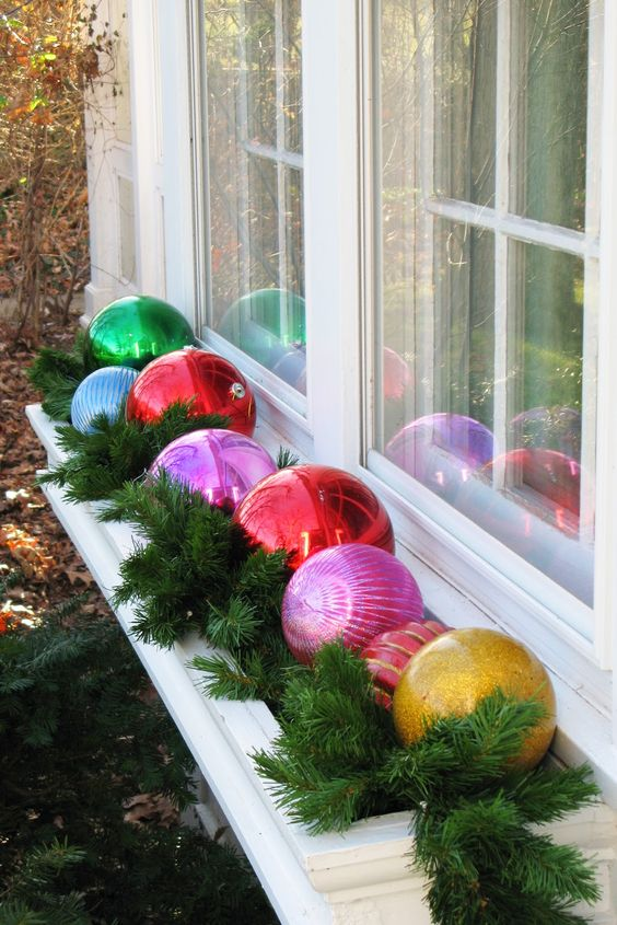 oversized ornaments and evergreens for decoratign window boxes