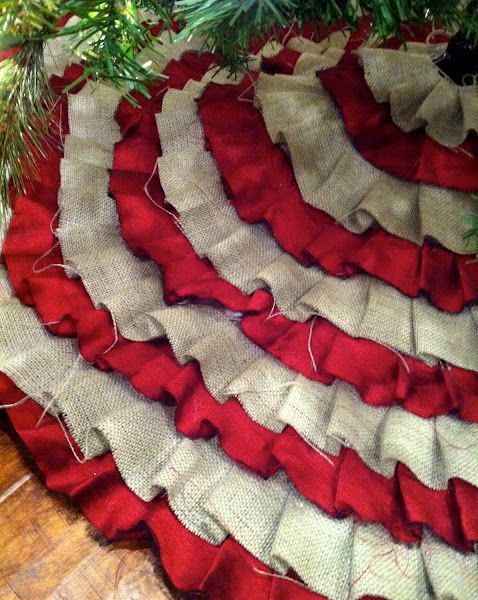 a burlap and red fabric tree skirt for the Christmas tree