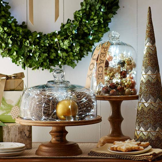 cloches with various ornaments and LEDs are always a great idea for holiday decor