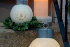 04 oversized frosted ornament lanterns and greenery wreaths to decorate the stairs
