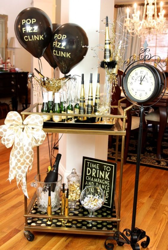 a gold and black bar cart with balloons, a polka dot bow and polka dot paper